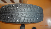 Продам зимние шипованые шины 185/70R14 на дисках .